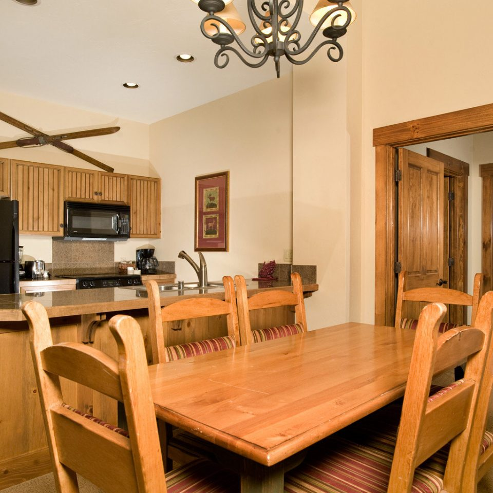 Kitchen Lodge Rustic wooden chair property home cottage hardwood Suite Dining living room dining table