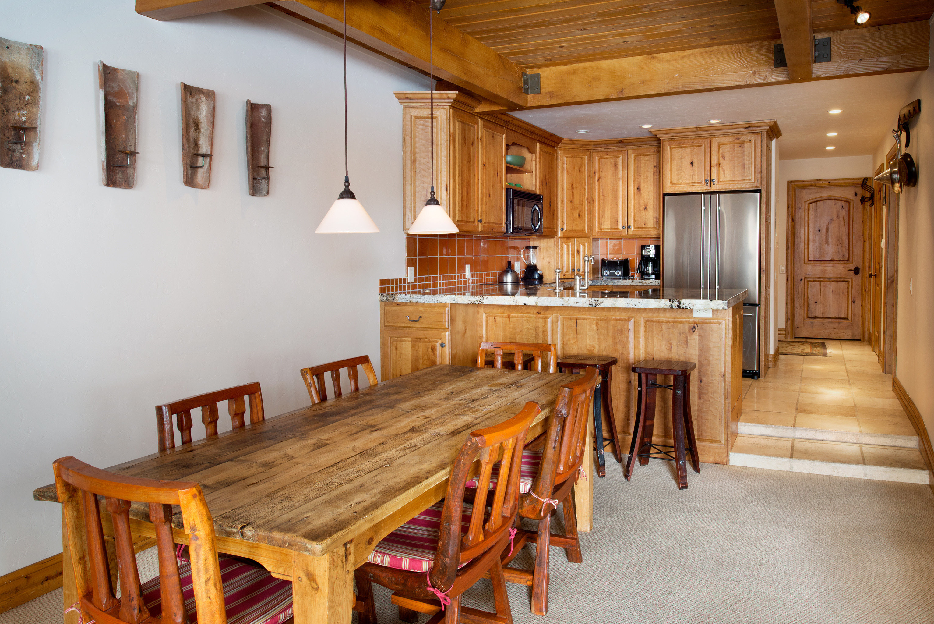Kitchen Rustic wooden property home hardwood cottage farmhouse log cabin Dining Villa recreation room living room dining table