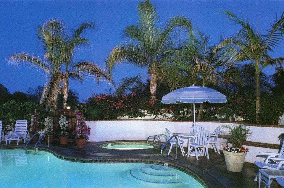 tree umbrella swimming pool property Resort caribbean Villa Pool Dining condominium resort town palm Lagoon mansion