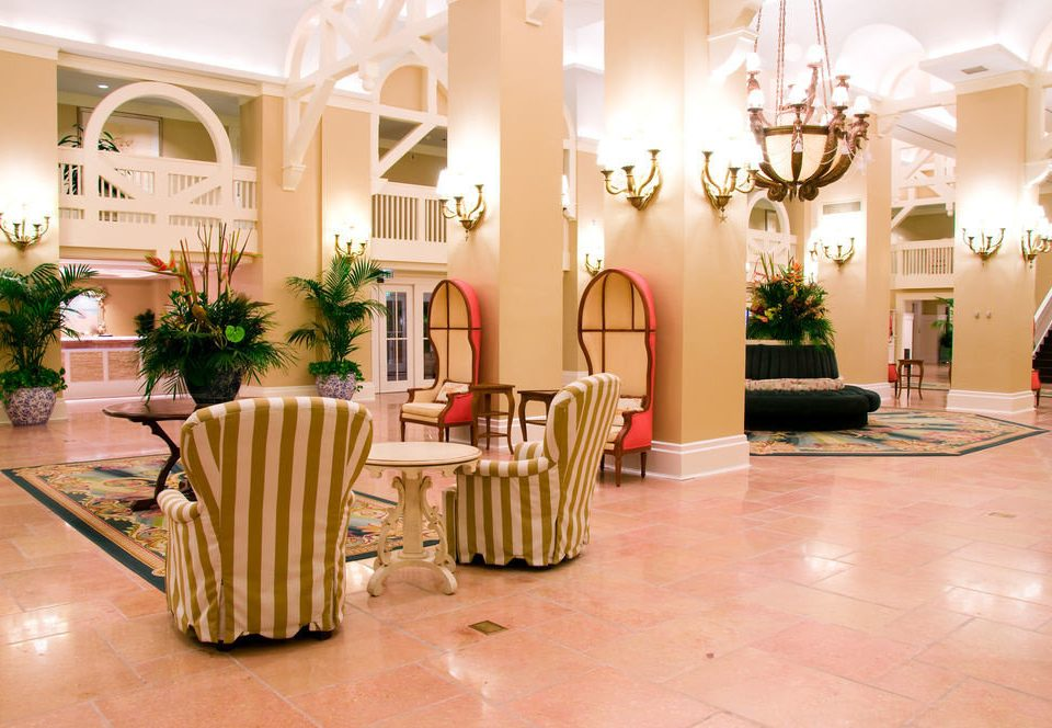 Lobby property Dining function hall home flooring ballroom restaurant living room hall mansion plant dining table