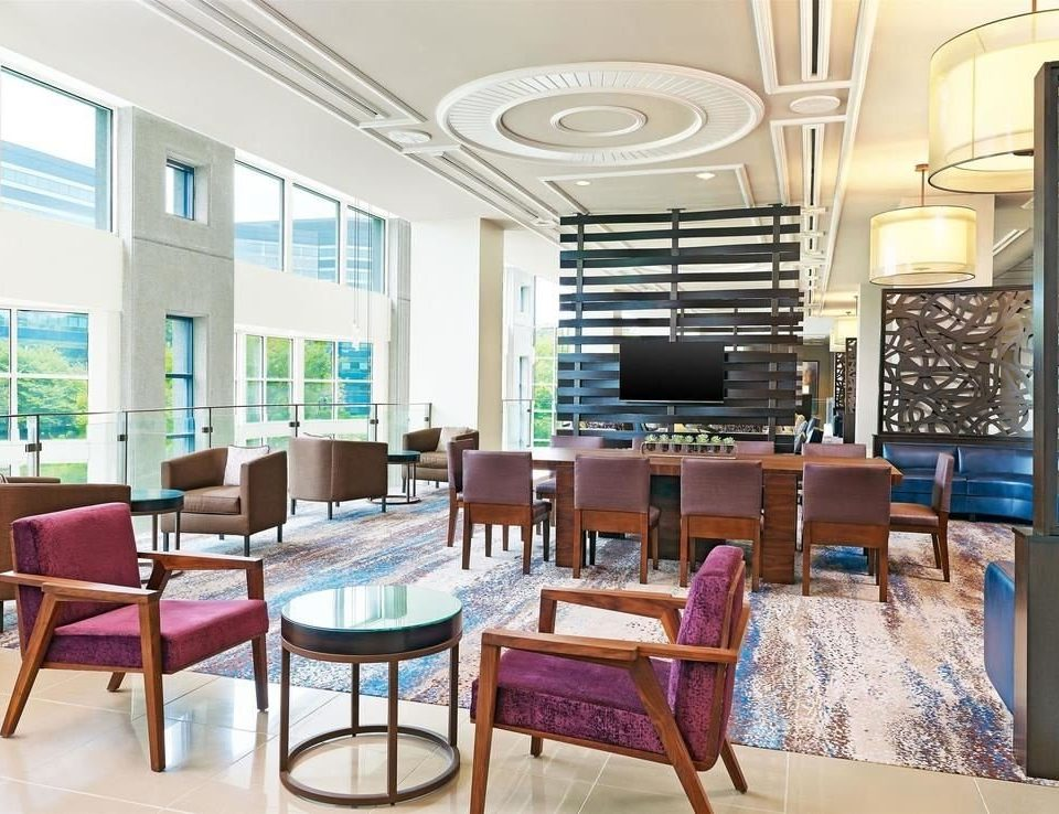 chair property Dining condominium living room Lobby home waiting room classroom conference hall dining table