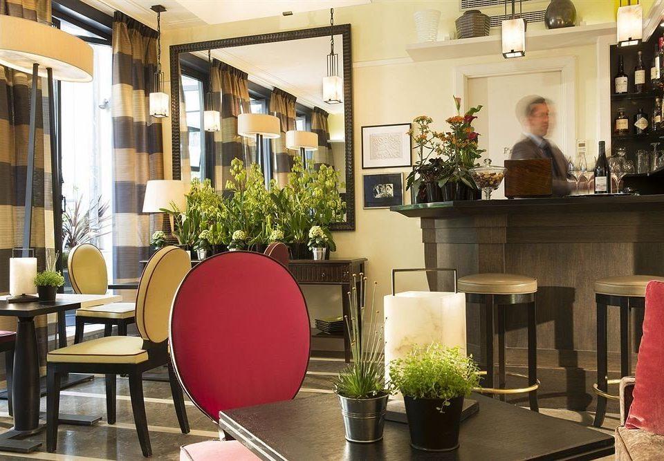 chair property Lobby floristry home restaurant Dining living room condominium