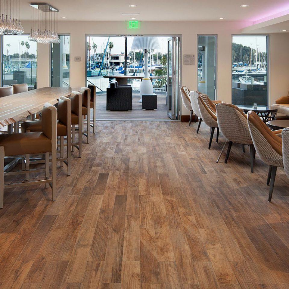 chair building property hardwood flooring wood flooring recreation room Lobby conference hall living room Dining Modern