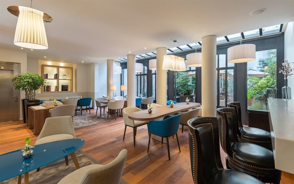 chair property condominium living room Dining home Resort Suite Villa Lobby Modern dining table