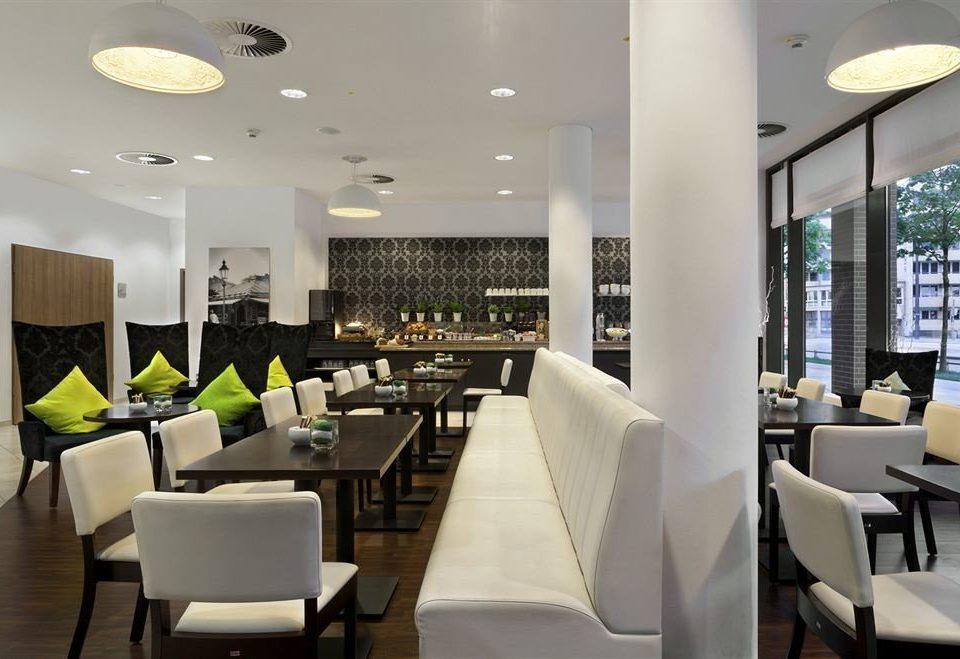 chair property Lobby restaurant condominium Dining function hall living room Resort Modern set dining table