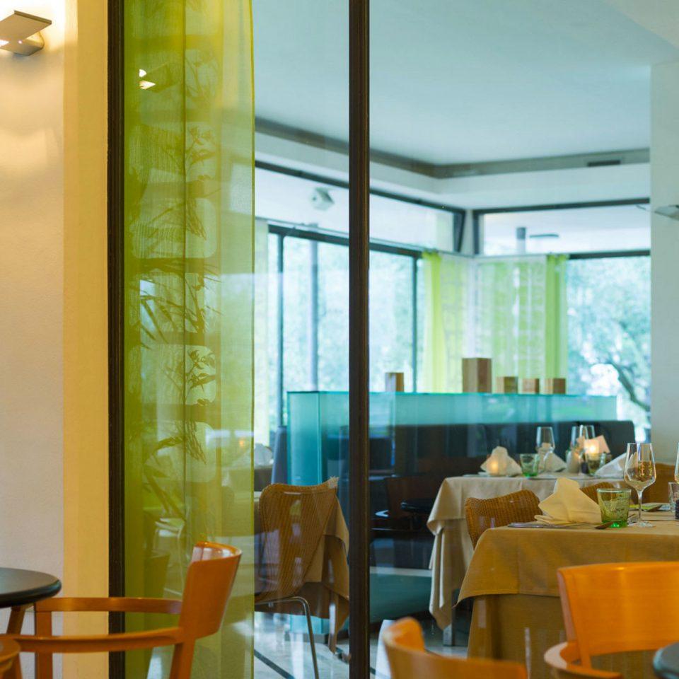 chair property Dining restaurant condominium Lobby Resort living room dining table