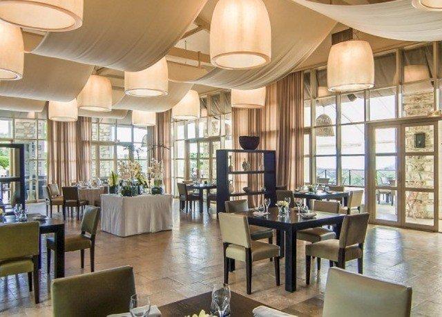 chair property Dining condominium Lobby Resort restaurant living room open set dining table
