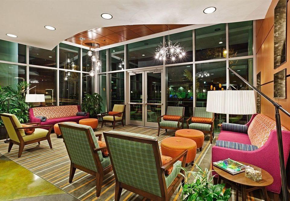 chair property condominium Lobby Resort restaurant Dining living room set dining table