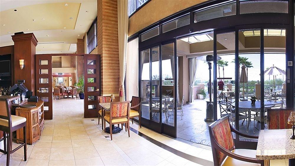 chair property Lobby restaurant Dining condominium Resort dining table