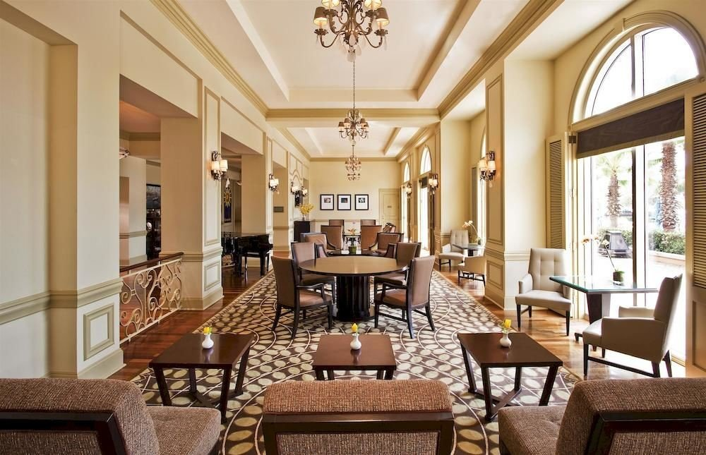 chair property Dining living room Lobby home mansion Suite Resort palace condominium dining table