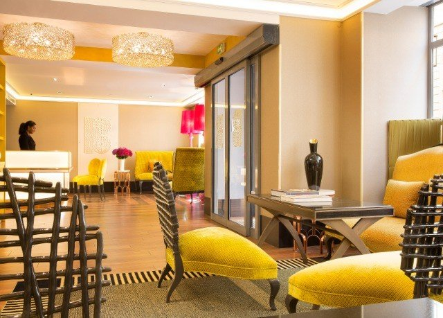 yellow chair property Dining Lobby living room condominium Suite function hall restaurant Resort waiting room