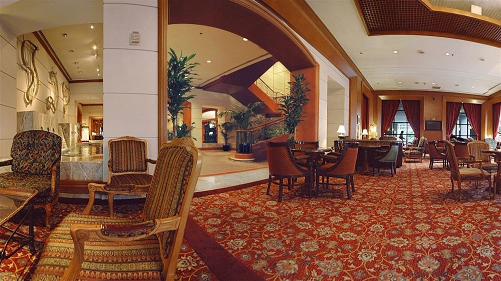 chair property Lobby Resort mansion palace Suite Villa restaurant function hall hacienda Dining rug