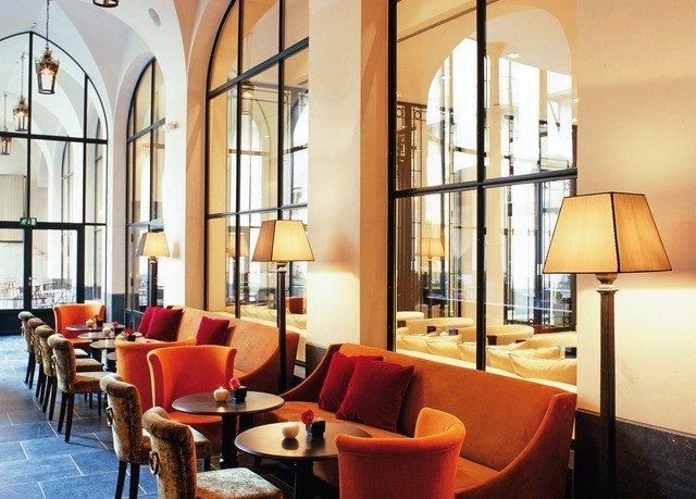 chair property restaurant Dining Lobby living room Suite orange condominium Resort