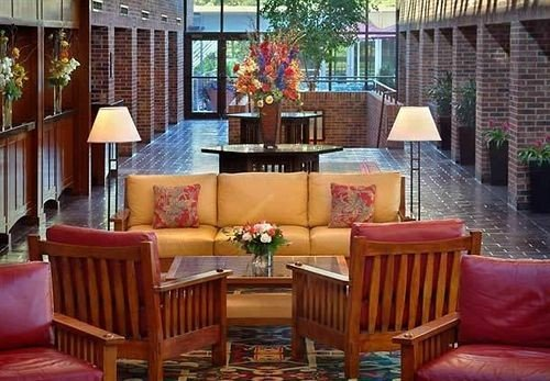 sofa chair property living room home Dining outdoor structure Resort Lobby Villa porch hacienda cottage condominium leather