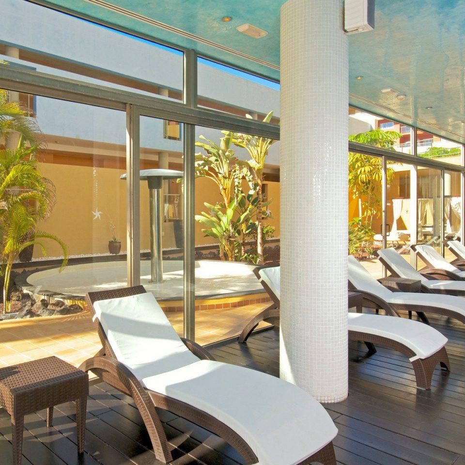 chair property leisure Resort building condominium restaurant Dining Lobby Villa home porch
