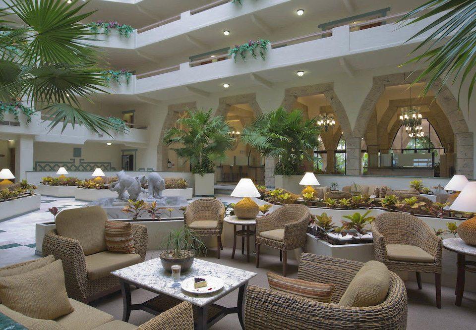 chair Lobby property condominium restaurant living room Resort home function hall Villa Dining set