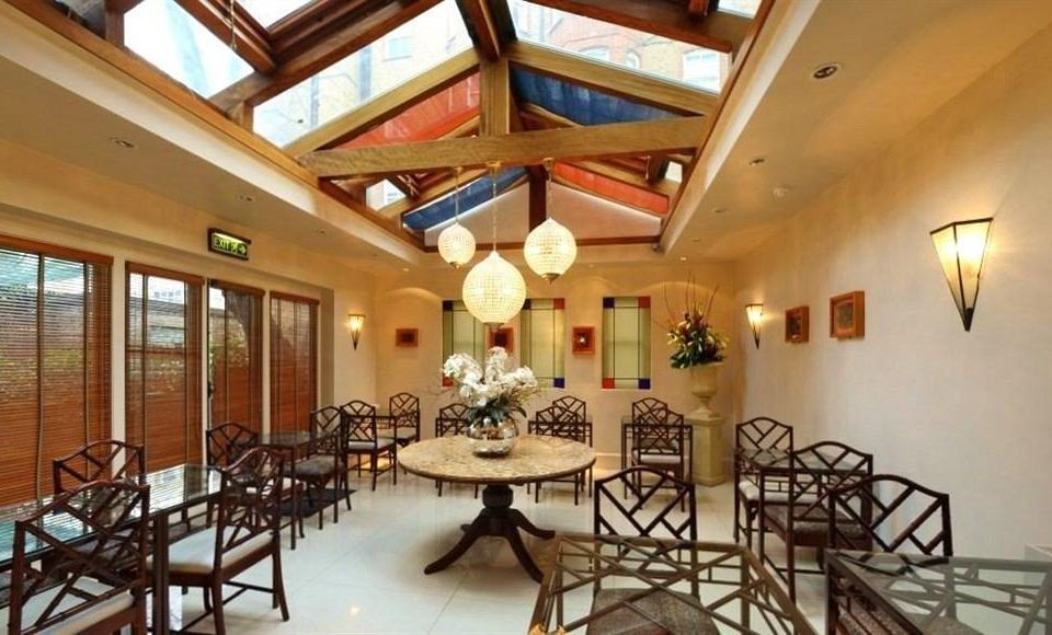 property chair Dining restaurant Resort home cottage Villa palace mansion function hall Lobby dining table