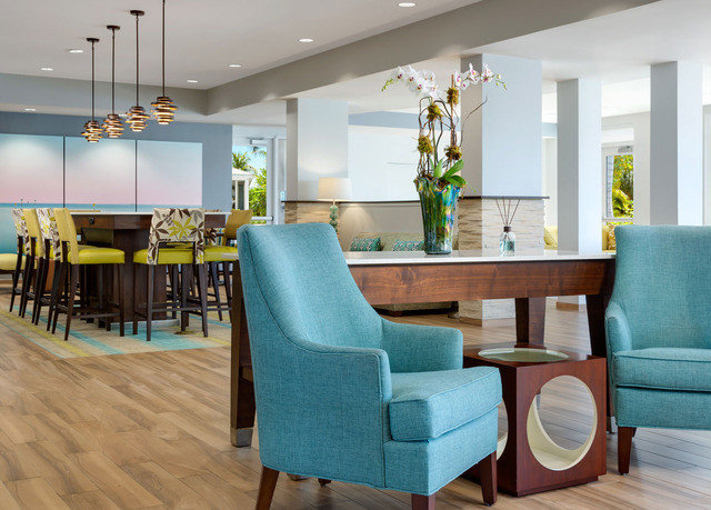 chair property living room home condominium hardwood green waiting room Lobby Suite Dining blue