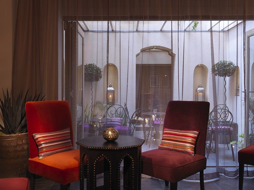 chair property living room Lobby Suite restaurant Dining