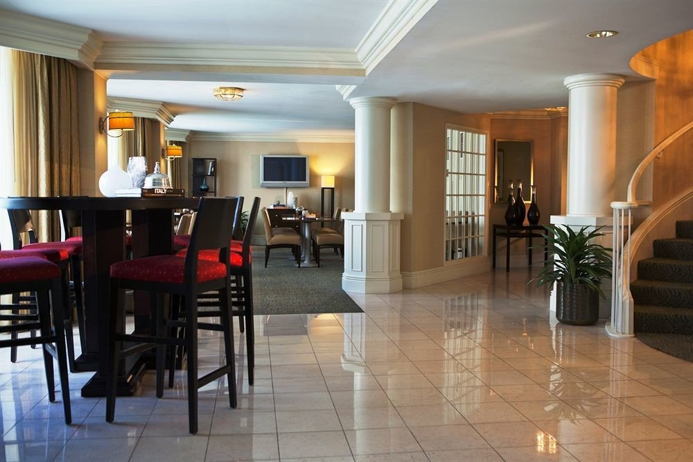 chair property Lobby hardwood Dining flooring home condominium wood flooring living room Suite