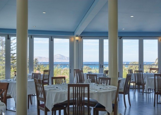 chair Dining property Resort condominium Ocean restaurant porch set overlooking dining table