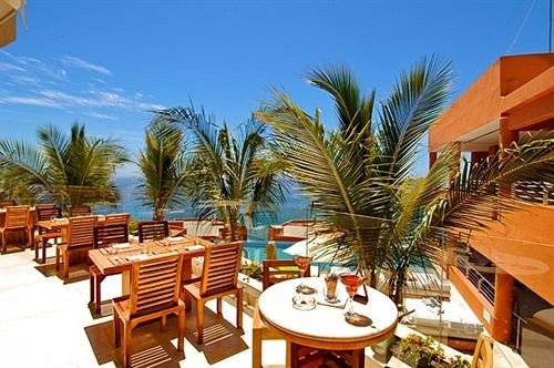 Dining Ocean Resort chair palm property caribbean Villa eco hotel condominium lined