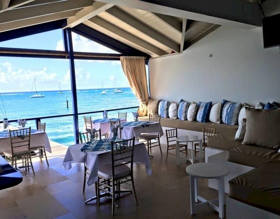 Dining Waterfront chair property restaurant Ocean Resort Villa cottage