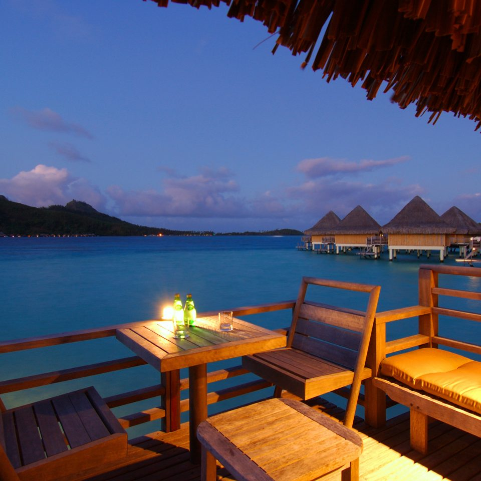 Dining Overwater Bungalow Scenic views water sky chair umbrella Resort Sea Villa