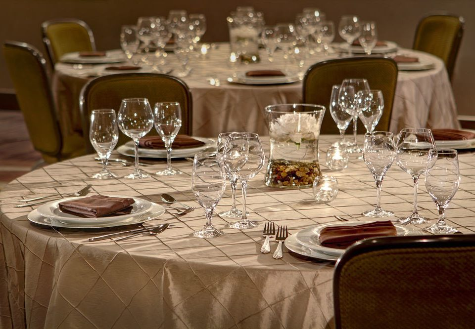 wine glasses sitting restaurant banquet centrepiece dinner Dining function hall empty Party set tablecloth ballroom wedding reception dining table