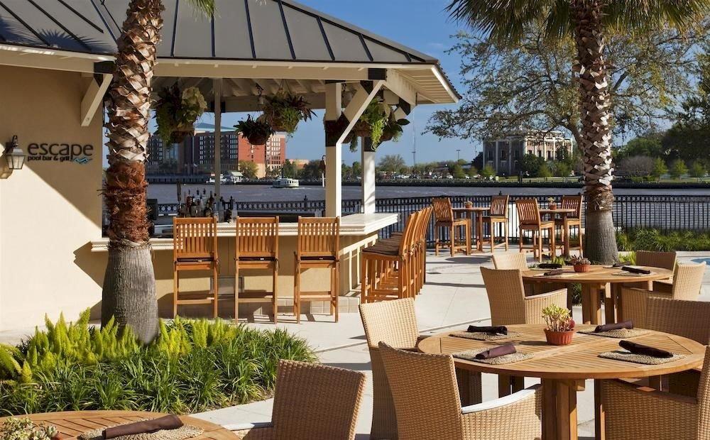 tree chair property building Resort Villa home cottage outdoor structure backyard Dining hacienda Patio