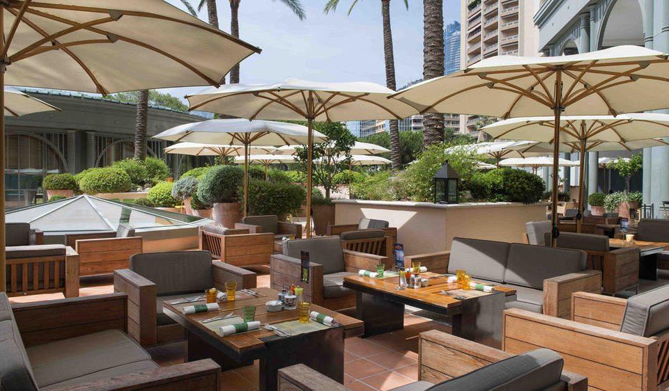 chair property Resort outdoor structure restaurant Dining condominium Villa Patio set