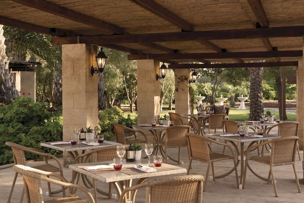 chair property porch outdoor structure backyard cottage Patio pergola Dining Villa farmhouse restaurant dining table