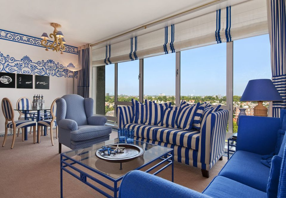 chair property striped living room Dining condominium home Suite Pool Villa Resort blue set
