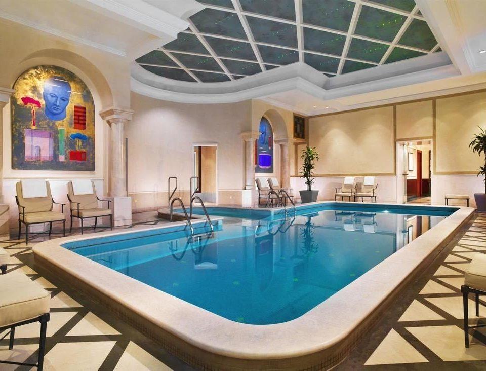 chair swimming pool property blue leisure Resort billiard room Villa mansion recreation room home Dining condominium Pool