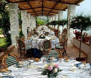 Dining banquet restaurant function hall ceremony Resort floristry wedding reception porch set dining table