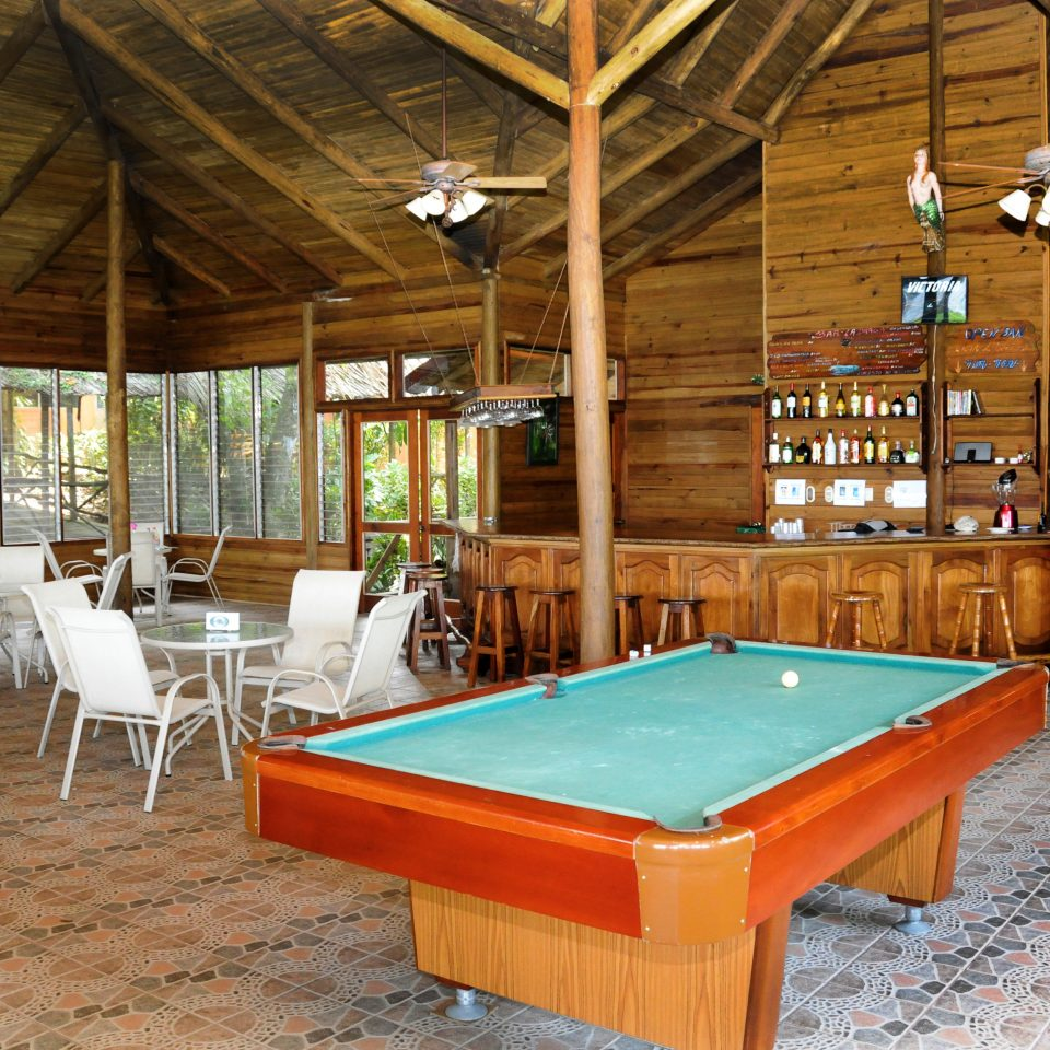 chair billiard room recreation room Resort swimming pool cottage log cabin Dining farmhouse outdoor structure poolroom