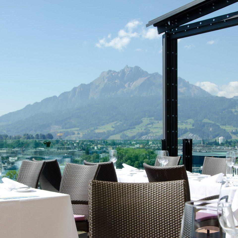 Dining outdoor dining outdoor seating restaurant view mountain sky property building Resort overlooking