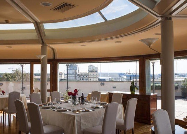 chair property restaurant Dining function hall Resort convention center yacht overlooking dining table