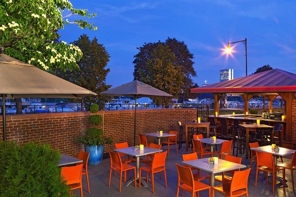 tree chair umbrella property Resort Dining lawn restaurant cottage set