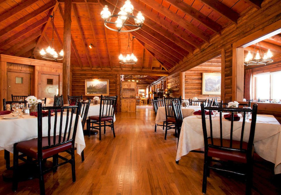 chair Dining property restaurant wooden cottage Resort farmhouse function hall