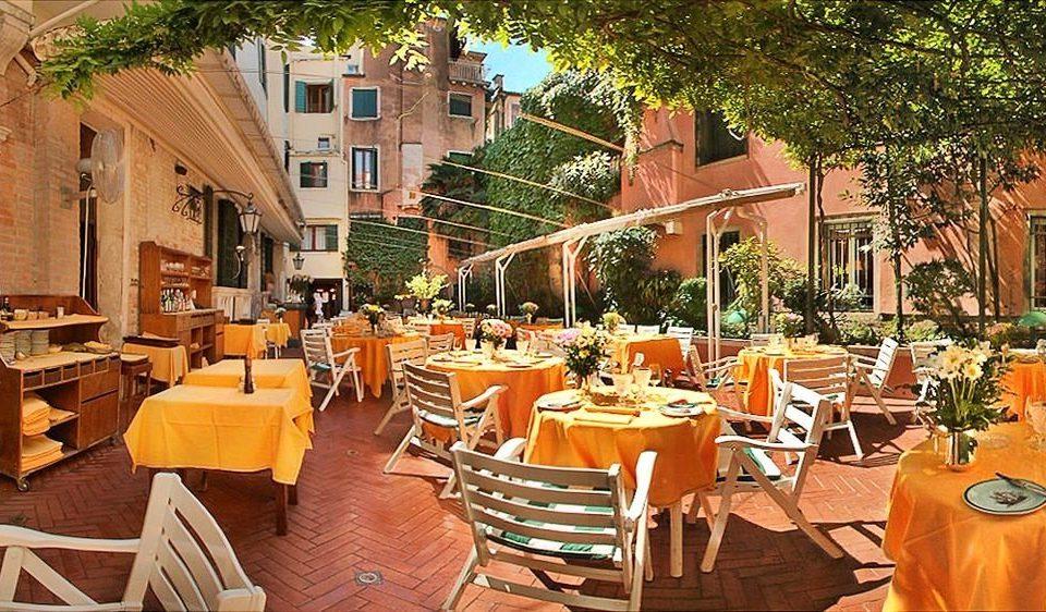 chair Dining property restaurant Resort hacienda cottage orange set