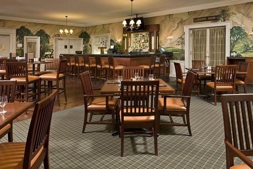 chair Dining property wooden restaurant Resort set dining table surrounded