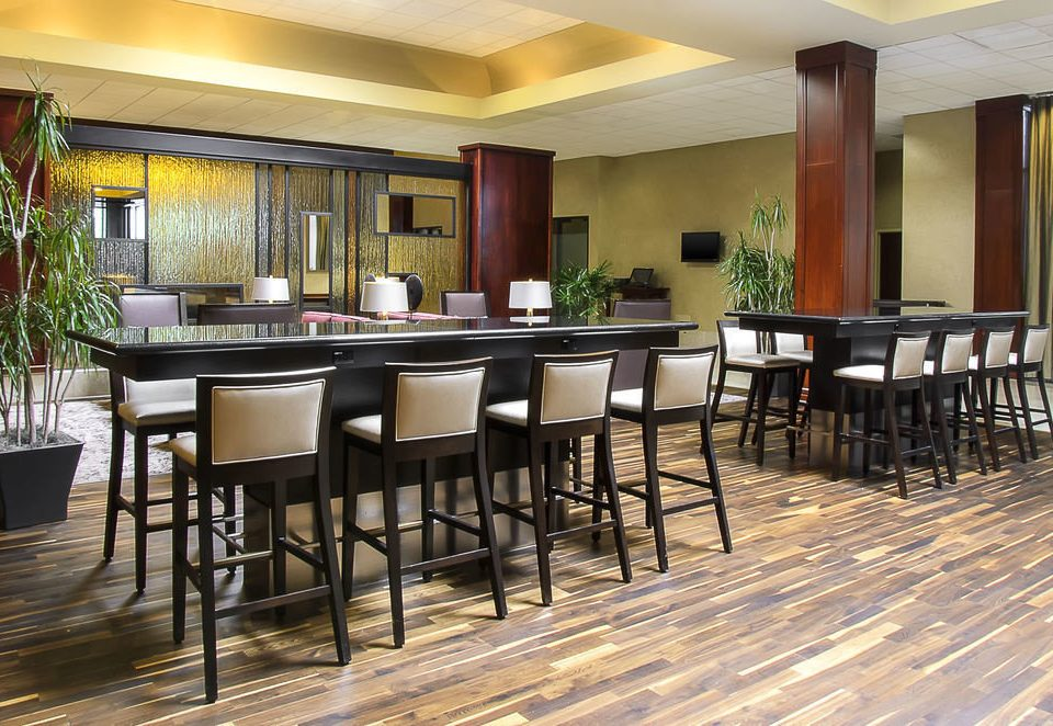 chair property Dining hardwood restaurant wood flooring flooring Resort dining table