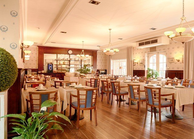 chair property Dining restaurant wooden function hall Resort hard