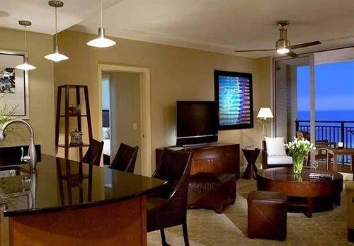 chair property Dining condominium Suite living room Resort set
