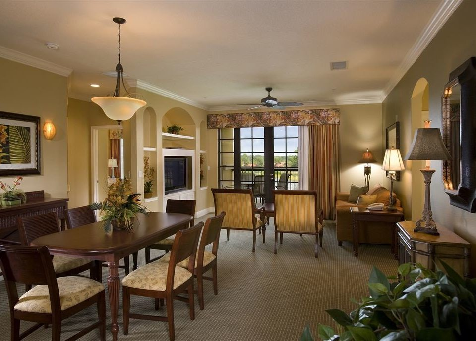 chair property Dining home condominium living room Villa Suite mansion cottage Resort dining table