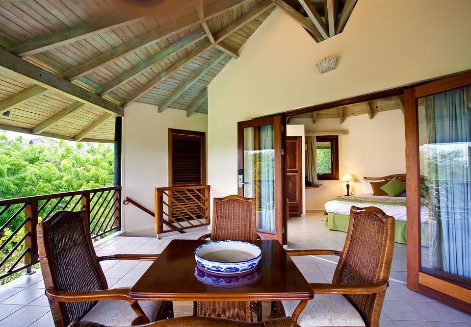 chair property home house Villa cottage Resort living room condominium farmhouse Dining Suite mansion dining table