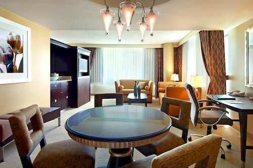 chair property Dining living room Suite recreation room home condominium Resort cottage Villa dining table