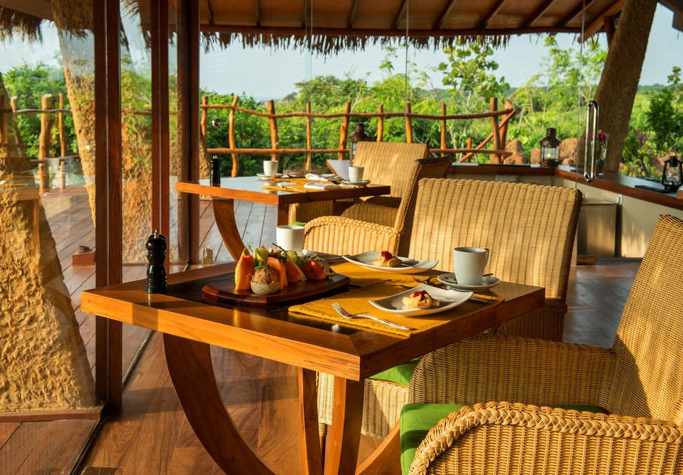 chair property Dining Resort cottage Villa restaurant outdoor structure home eco hotel backyard porch
