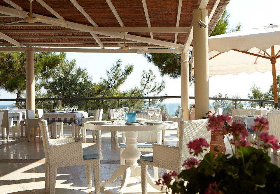 chair property building flower Resort restaurant Dining outdoor structure backyard porch Villa
